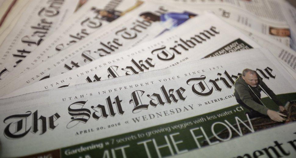 FILE - This April 20, 2016, file photo shows copies of The Salt Lake Tribune newspaper in Salt Lake City. (AP Photo/Rick Bowmer, File)