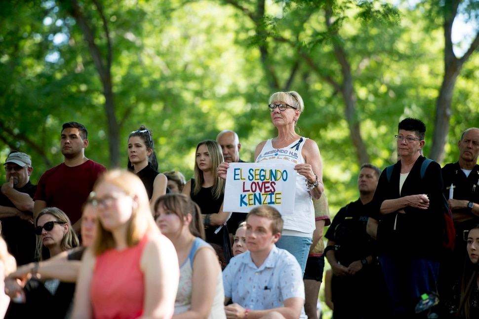 (Jeremy Harmon | The Salt Lake Tribune) Denise Dial, a longtime friend of the Lueck family, holds a sign in remembrance of MacKenzie Lueck during a vigil at the University of Utah on Monday, July 1, 2019.