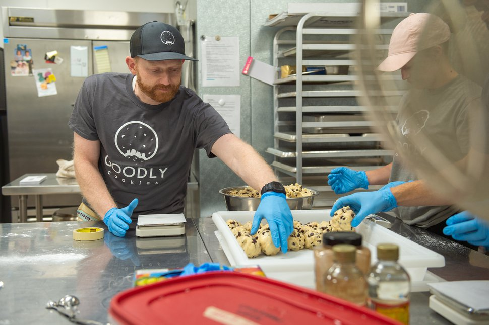 (Rachel Molenda | The Salt Lake Tribune) Brandon Plewe, Goodly Cookies co-owner, and Isabell Drake shape 6 ounces of gluten-free chocolate chip cookie dough before baking on Wednesday, June 6, 2018. The Salt Lake City cookie delivery service uses Amour Café's kitchen on 500 East and 1300 South in Salt Lake City.