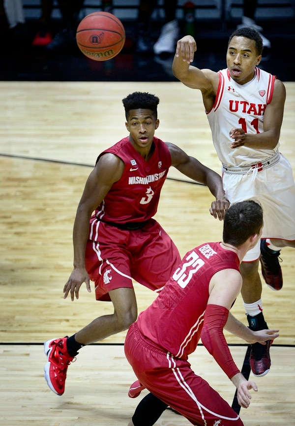 Scott Sommerdorf | The Salt Lake Tribune Utah Utes guard Brandon Taylor (11) passes during first half play over Washington State Cougars guard Ny Redding (3) as Utah routed Washington State 88-47, Sunday, February 14, 2016.