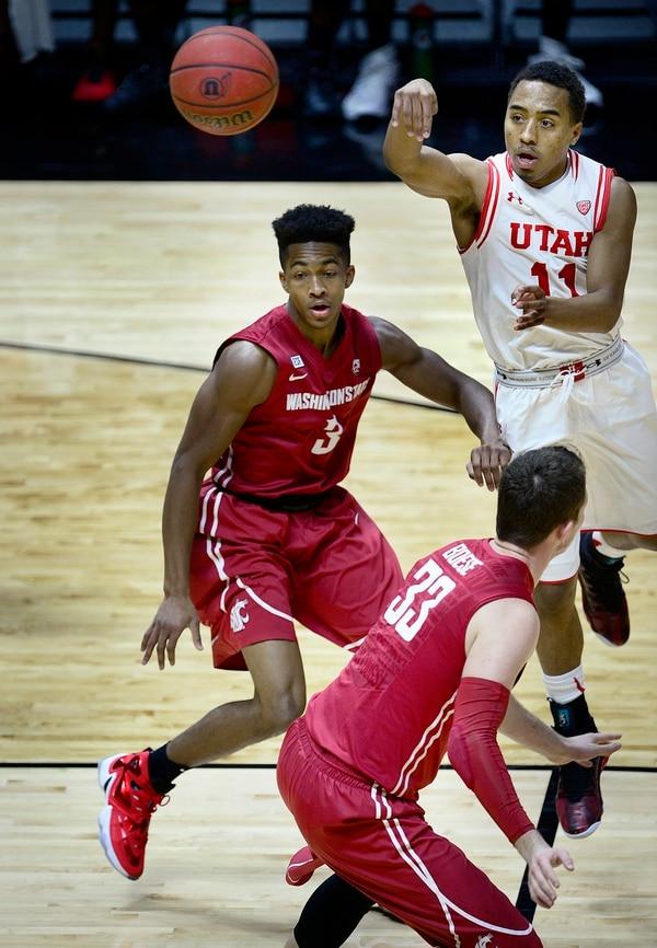 Scott Sommerdorf   The Salt Lake Tribune Utah Utes guard Brandon Taylor (11) passes during first half play over Washington State Cougars guard Ny Redding (3) as Utah routed Washington State 88-47, Sunday, February 14, 2016.