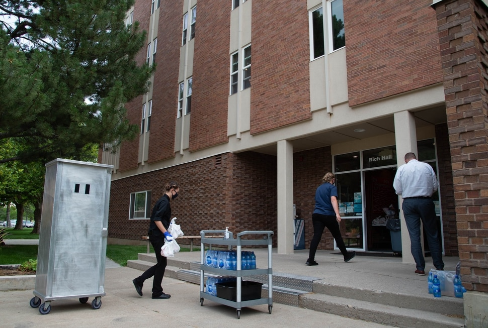 (Francisco Kjolseth | The Salt Lake Tribune) University catering delivers bag lunches to four Utah State University dormitories on Monday, August 0831, 2020, where 287 residents were asked to quarantine after elevated levels of COVID-19 were found in wastewater samples.