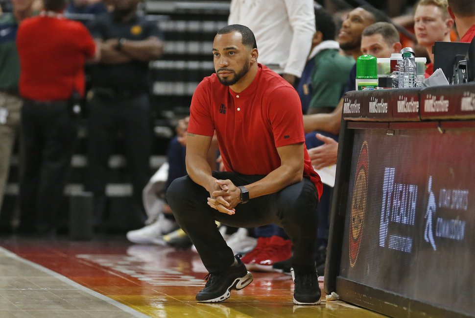 Utah Jazz coach Lamar Skeeter watches during the first half of the team's NBA summer league basketball game against the San Antonio Spurs on Wednesday, July 3, 2019, in Salt Lake City. (AP Photo/Rick Bowmer)