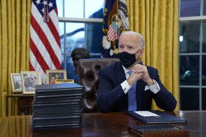 (Evan Vucci | AP) President Joe Biden waits to sign his first executive order in the Oval Office of the White House on Wednesday, Jan. 20, 2021, in Washington.An order starting the restoration of original boundaries to Bears Ears National Monument and Grand Staircase-Escalante National Monument were expected to be among the initial orders signed.