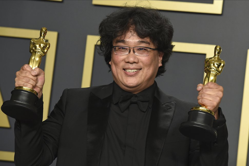 (Jordan Strauss | Invision/AP file photo) Bong Joon Ho poses in the press room with the awards for best director for