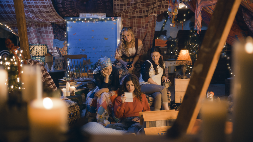 (Photo courtesy Pinnacle Peak Pictures) The older March sisters — clockwise from top, Amy (Taylor Murphy), Meg (Melanie Stone), Jo (Sarah Davenport) and Beth (Allie Jennings) — read old notes by their younger selves, in a scene from director Clare Niederpruem's modern-day adaptation of Louisa May Alcott's Little Women.