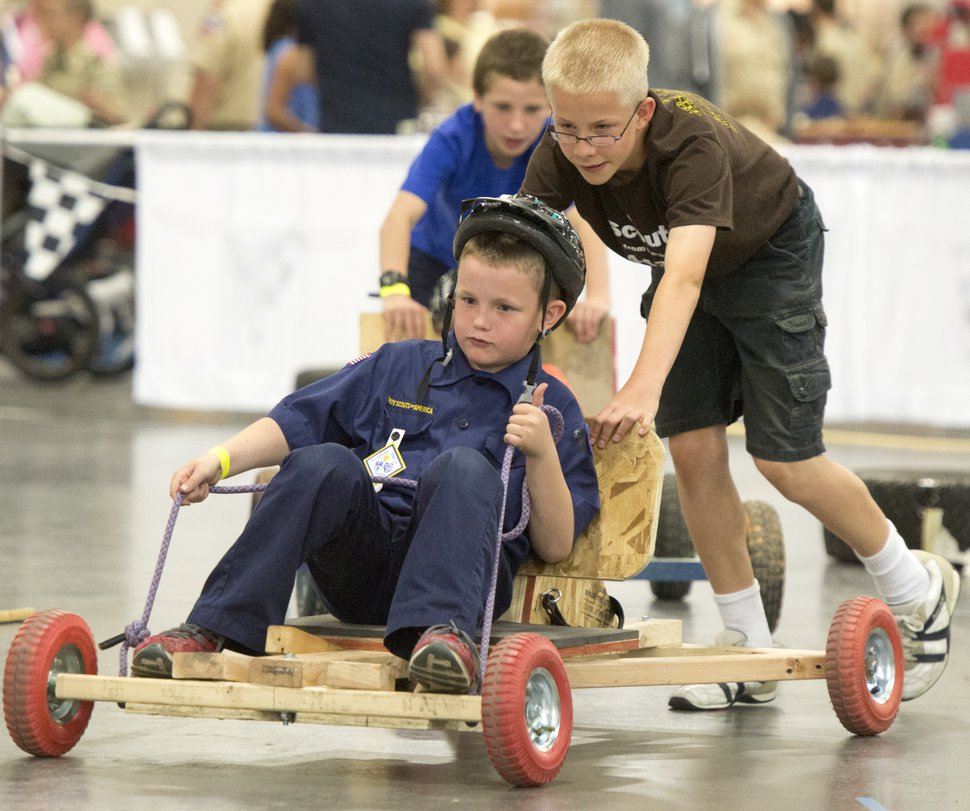 Rick Egan | The Salt Lake Tribune Lincoln Halladay, 11, pushes his brother Elisha, 8, in the Push Cart Derby, at the Utah Scouting Expo at the South Towne Expo Center on Saturday, May 2, 2015.