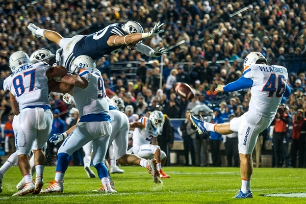 (Chris Detrick | The Salt Lake Tribune) Brigham Young Cougars defensive lineman Corbin Kaufusi (90) attempts to block a punt by Boise State Broncos place kicker Joel Velazquez (46) during the game LaVell Edwards Stadium Friday, October 6, 2017.