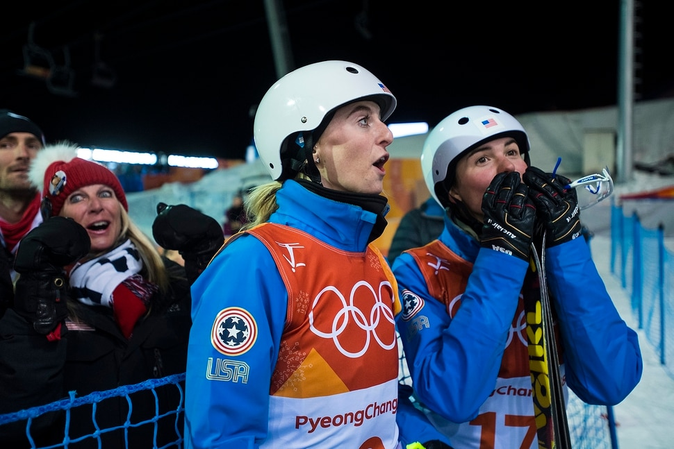 (Chris Detrick | The Salt Lake Tribune) USA's Kiley McKinnon, left, and USA's Madison Olsen react after learning they both qualified for the finals during the Ladies' Aerials Qualification at Phoenix Park during the Pyeongchang 2018 Winter Olympics Thursday, Feb. 15, 2018.