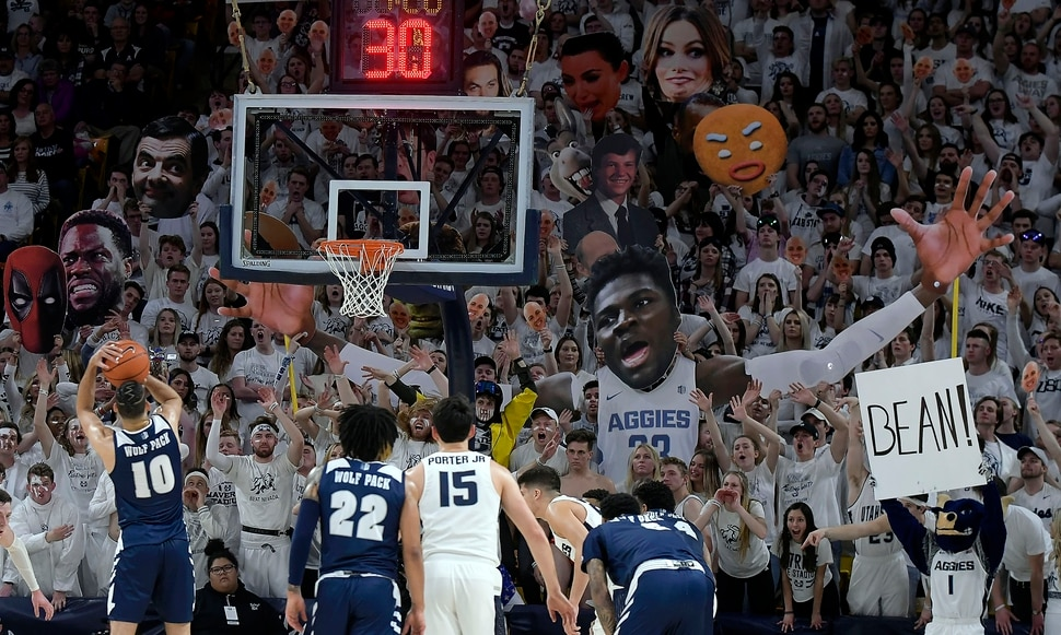 (Eli Lucero | The Herald Journal via AP) Utah State fans try to distract Nevada forward Caleb Martin (10) as he shoots a free throw during an NCAA college basketball game Saturday, March 2, 2019, in Logan, Utah.