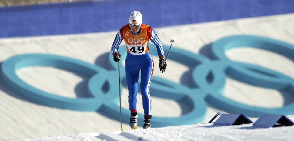 Russia's Olga Danilova skiis up the first hill past the hughe Olympic rings in the 10K Classical race at Soldier Hollow. She took second in the event behind Norway's Bente Skari. Hartmann/photo 2/12/02