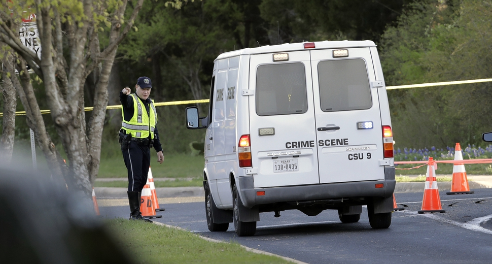A police crime scene van arrives near the site of Sunday's deadly explosion, Monday, March 19, 2018, in Austin, Texas. Police warned nearby residents to remain indoors overnight as investigators looked for possible links to other package bombings elsewhere in the city this month. (AP Photo/Eric Gay)