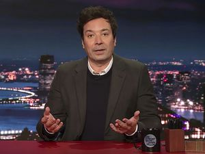 """This image released by NBC shows host Jimmy Fallon during his monologue Wednesday, Jan. 6, 2021 on """"The Tonight Show Starring Jimmy Fallon."""" (NBC via AP)"""