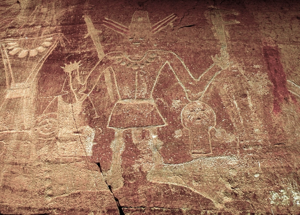 (Erin Alberty|The Salt Lake Tribune) Fremont petroglyphs show a character known as Big Foot Man standing near what appears to be a severed head, at McConkie Ranch in Dry Fork Canyon near Vernal. Photo taken July 23, 2009.