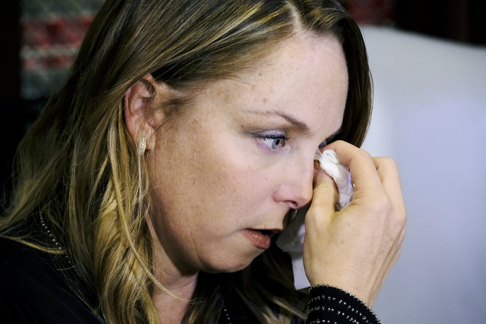 (AP Photo/Richard Vogel) Louisette Geiss, an alleged sexual harassment victim of entertainment executive Harvey Weinstein, wipes a tear from her eye after talking at a news conference in Los Angeles on Tuesday, Oct. 10, 2017. Geiss said in a statement that she is coming forward to help give voice to other alleged victims of sexual harassment.