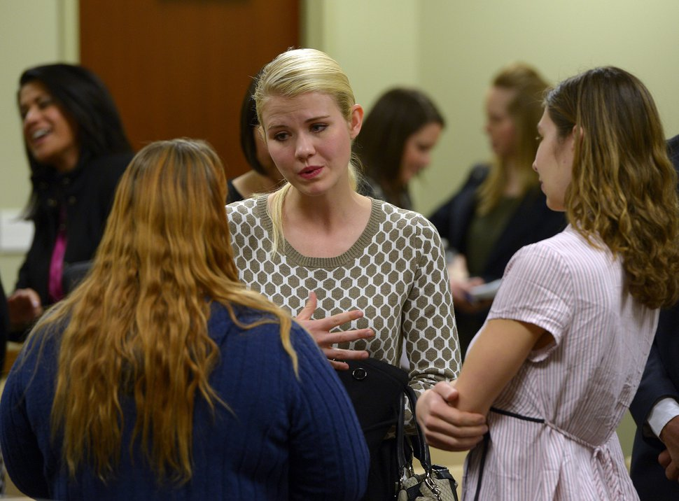 (Scott Sommerdorf   Tribune file photo) Elizabeth Smart speaks with others who attended the committee meeting where HB286, a child sexual abuse prevention act, was heard in committee, Wednesday, Feb. 19, 2014.