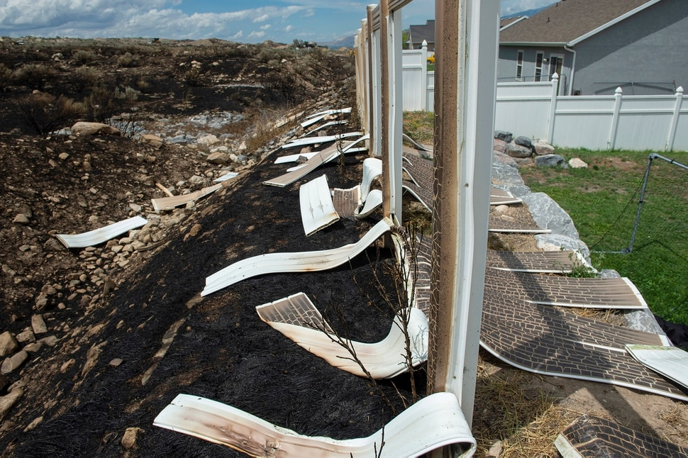 (Rick Egan | The Salt Lake Tribune) The Knolls fire melted fences and did some property damage, but spared the homes on Sunrise Drive in Sunday's fire, in Saratoga Springs, Monday, June 29, 2020.