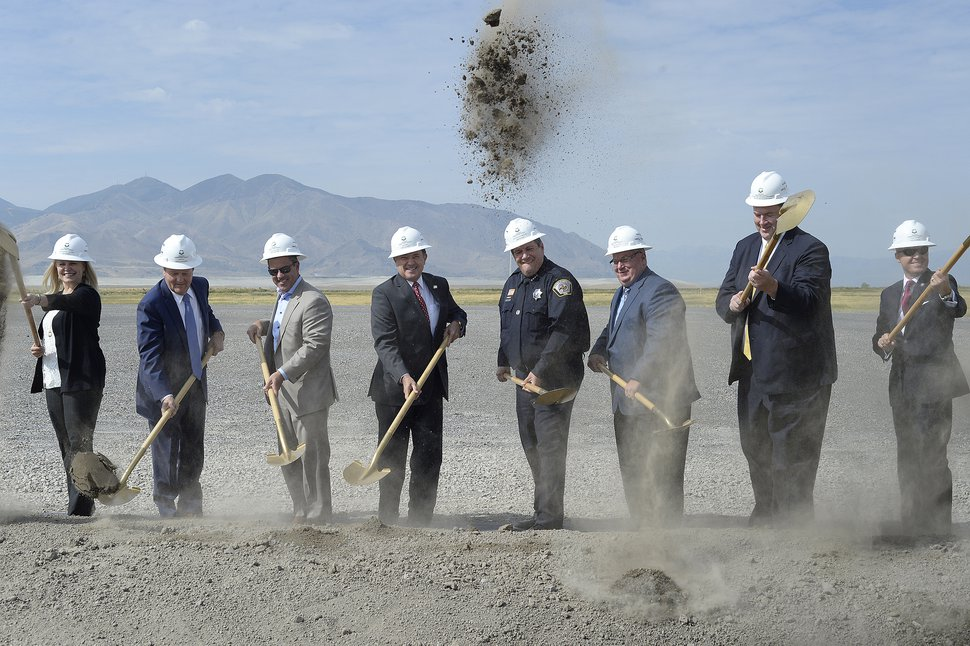 (Scott Sommerdorf | Tribune file photo) Utah Gov. Gary Herbert, center, turns dirt along with other dignitaries at the site of the new prison, Aug.t 16, 2017. Rep. Brad Wilson, R-Layton, is left of Herbert, and then-Corrections Director Rollin Cook is to the right.