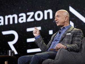 FILE - Amazon CEO Jeff Bezos speaks at the the Amazon re:MARS convention in Las Vegas on June 6, 2019. (AP Photo/John Locher, File)