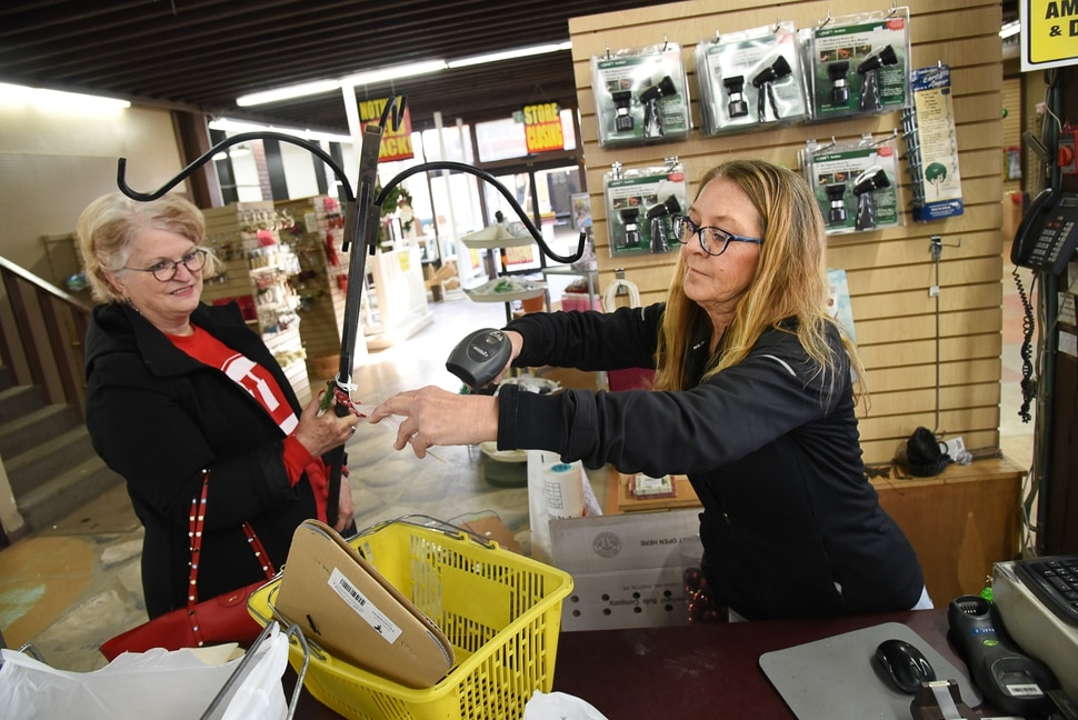 (Francisco Kjolseth | The Salt Lake Tribune) Cathy Jones, left, takes advantage of extreme markdowns on the last day of business at Wasatch Shadows Nursery in Sandy as owner Debbie Nielsen rings up her purchases. After 42 years, Debbie and her husband Loren are retiring. They had the most unique items here and knowledgeable staff, exclaimed Jones while picking up several items on the last official day of business.