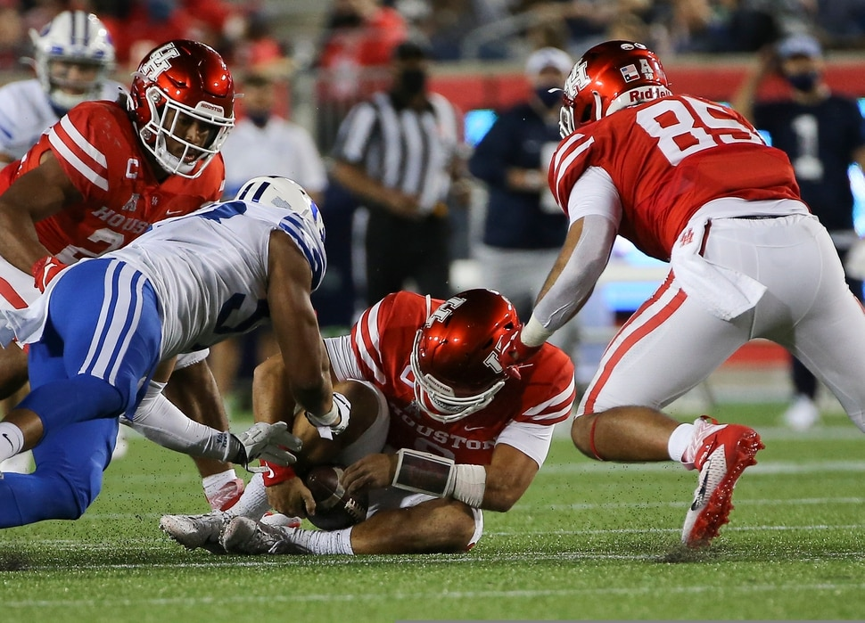 Houston quarterback Clayton Tune (3) fumbles but recovers the ball during the third quarter of an NCAA college football game against BYU Friday, Oct. 16, 2020, in Houston. (Yi-Chin Lee/Houston Chronicle via AP)