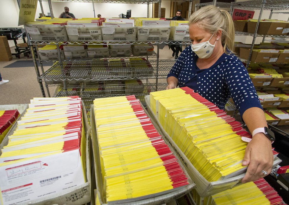 (Rick Egan | The Salt Lake Tribune) Lannie Chapman, Chief Deputy Clerk, prepares primary election ballots for counting at the Salt Lake County Government Center on Wednesday July 1, 2020.