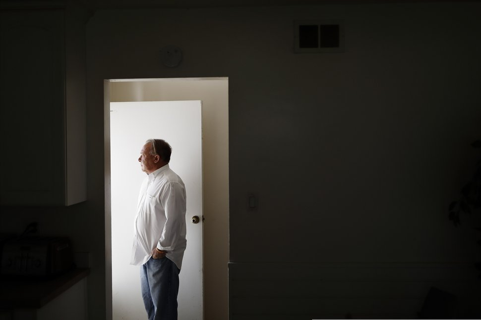 (Gregory Bull | AP) David Lasher stands for a portrait at his home in Carlsbad, Calif., on Friday, Oct. 4, 2019. When Lasher reported sexual abuse by a priest to an independent review board, the board ruled against him.