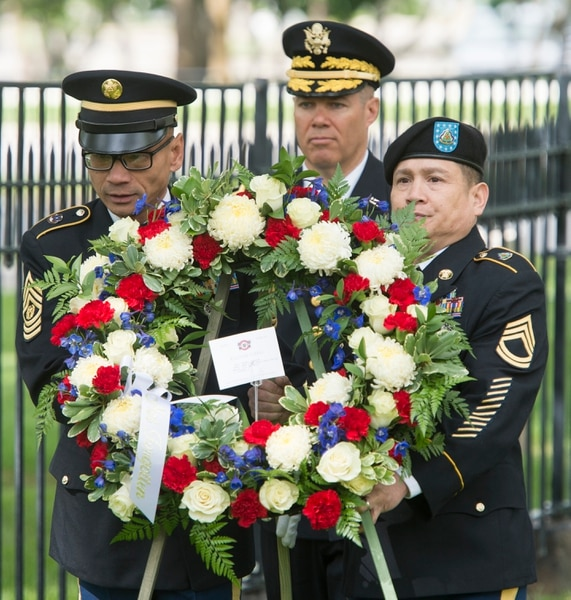 (Rick Egan | The Salt Lake Tribune) BG Doug Cherry, Dep Commanding General, 76th ORC walks with CSM Santi Khoudet (left) and (RET) Max Padua (right) for the laying of the wreath, during the Memorial Day observance at the Fort Douglas Cemetery, Monday, May 28, 2018.