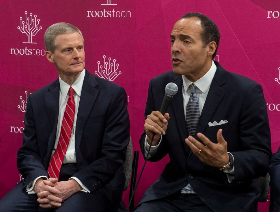 (Rick Egan | The Salt Lake Tribune) LDS apostle David A. Bednar, listens as Michael Boulware Moore, president of the International African American Museum, in Charleston South Carolina, discusses the LDS church's $2 million donation to the IAAM museum, at the RootsTech convention at the Salt Palace Convention Center, Wednesday, Feb. 27, 2019.