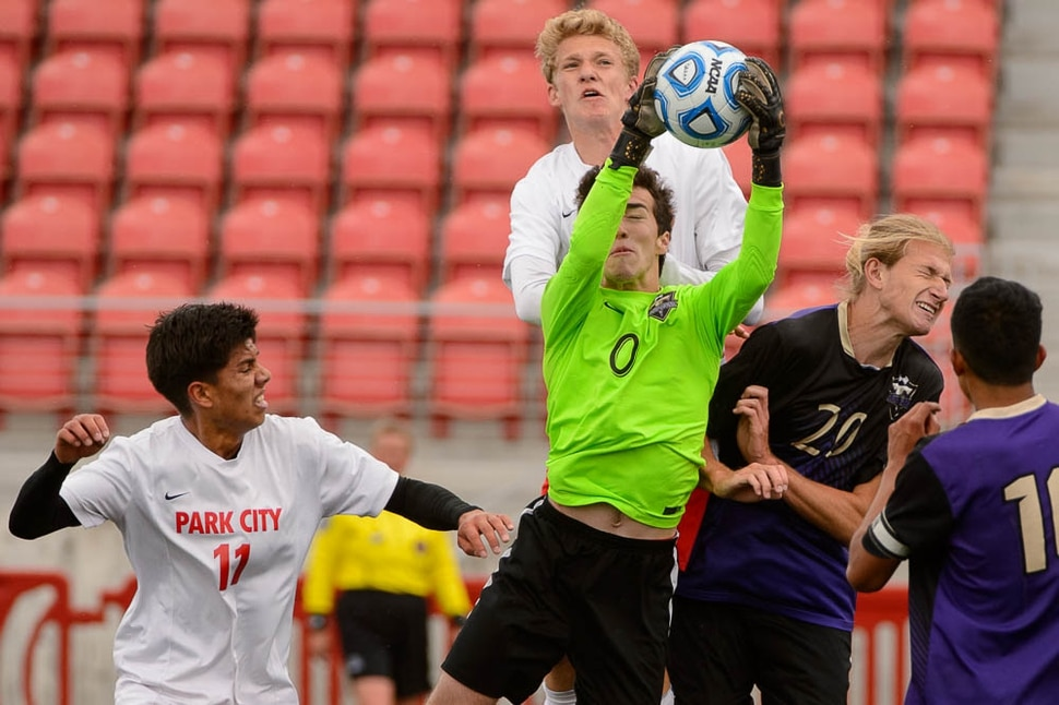 (Trent Nelson | The Salt Lake Tribune) Desert Hills goalkeeper Preston Hodges grabs the ball in the 4A state championship game vs. Park City High School, Saturday May 12, 2018.