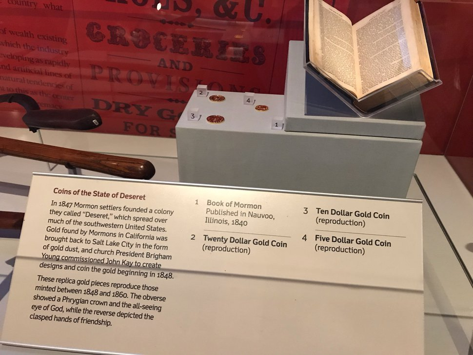 (Nate Carlisle | The Salt Lake Tribune) A third edition 1840 Book of Mormon and replica coins from the State of Deseret sit under a display case at the Gateway Arch museum in St. Louis on Aug. 22, 2019. The renovated museum focuses on St. Louis' role in westward expansion, including how it was a supply point and way station for pioneers traveling the Mormon Trail.
