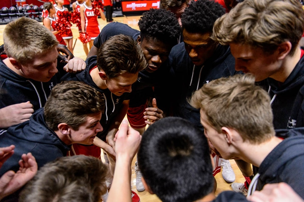(Trent Nelson | The Salt Lake Tribune) East vs. Timpanogos, 5A State high school basketball tournament at the Huntsman Center in Salt Lake City, Wednesday Feb. 28, 2018. East players huddle pre-game.