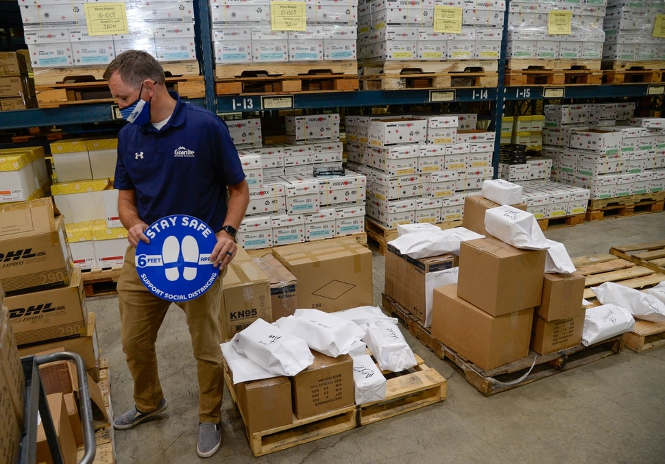 (Francisco Kjolseth | The Salt Lake Tribune) Granite School District communications director Ben Horsley overlooks PPE inventory being prepared to ship to schools for the start of classes next week from the Granite School District Warehouse on Tuesday, August 18, 2020.