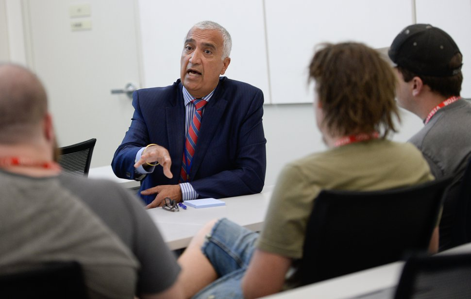 (Francisco Kjolseth | The Salt Lake Tribune) District Attorney Sim Gill speaks with organizers from Utah Against Police Brutality (UAPB) during a sit-down meeting at his office on Monday, Oct. 1, 2018, where he discusses his decision to not file charges against a West Valley City officer who shot and killed Elijah Smith. The decision has been widely criticized and rejected by UAPB.