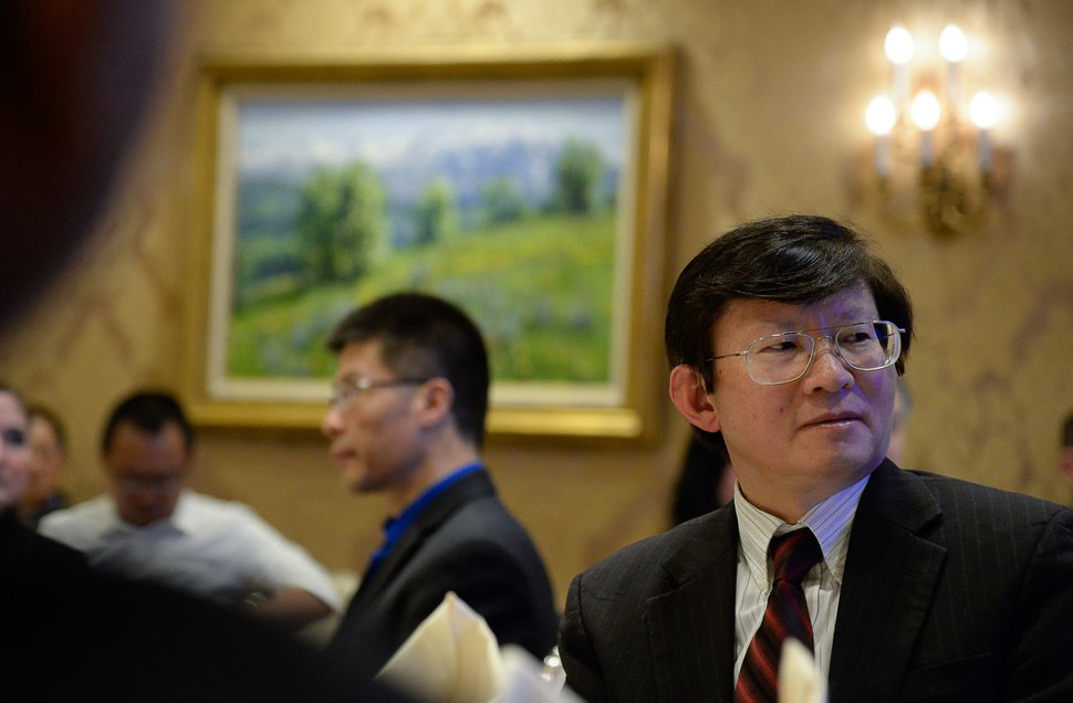 (Francisco Kjolseth | The Salt Lake Tribune) Volunteer Taowen Le joins Minister Xu Xueyuan, of the Chinese embassy in the United States, for a reception at Little America Hotel on Friday, Nov. 22, 2019, to thank everyone who cared for the Chinese tourists killed and injured in the bus crash Sept. 20 near Bryce Canyon National Park. The crash killed four passengers and injured 27 others aboard.