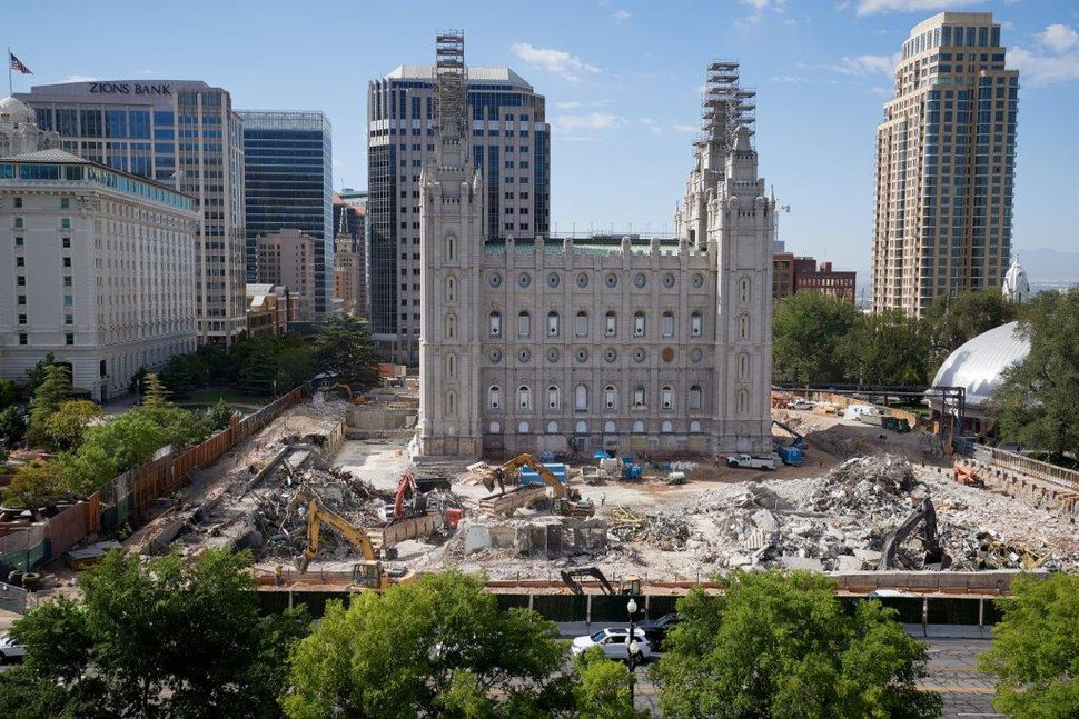 (Photo courtesy of The Church of Jesus Christ of Latter-day Saints) Piles of steel, copper, aluminum, stone and concrete are loaded and trucked to recycling plants from the Salt Lake Temple renovation project in this July 2020 photo. The sorting of the repurposed refuse is more time consuming but considered the right thing to do by the church and its contractors, the church said.