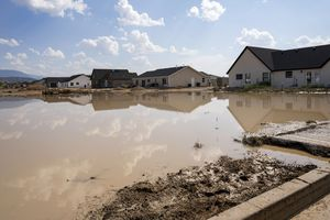 (Rick Egan | The Salt Lake Tribune) Standing water in a neighborhood of Enoch, from the heavy rains on Monday, Aug. 2, 2021.
