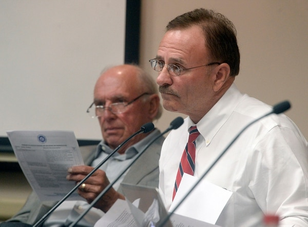 Al Hartmann | Tribune file photo Then-Salt Lake County Council Chairman Max Burdick listens as Salt Lake County County Recorder Gary Ott comments on findings of the County Auditor's performance audit of his office Tuesday, Oct. 4. Councilman Jim Bradley is at left.