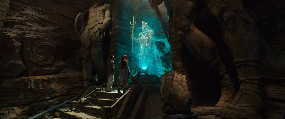 (Photo courtesy Warner Bros. Pictures) Arthur Curry (Jason Momoa, lower left) and Mera (Amber Heard, lower right) hear an ancient message from King Atlan (Graham McTavish) in a scene from DC Comics'