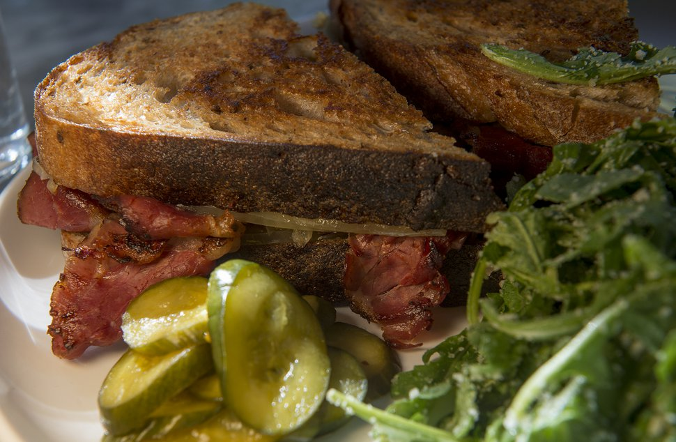 (Leah Hogsten | The Salt Lake Tribune) White Horse Spirits and Kitchen's Reuben with house pastrami, sauerkraut, gruyere and Russian dressing on rye, $12.