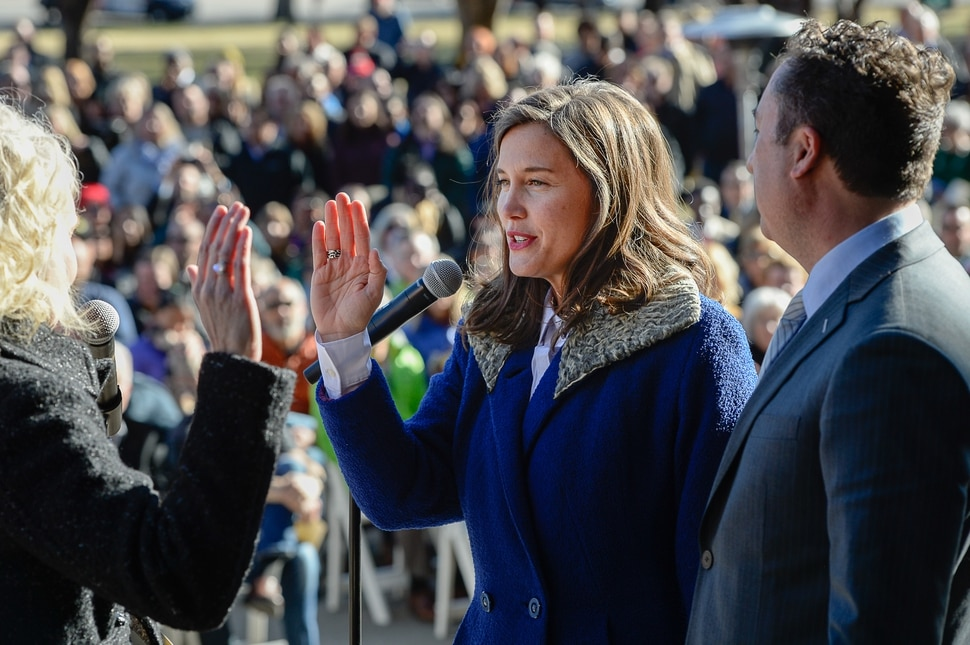 (Francisco Kjolseth | The Salt Lake Tribune) Erin Mendenhall is joined by her husband, Kyle LaMalfa, as she is administered the oath of office as Salt Lake City mayor by City Recorder Cindi Mansell, at Salt Lake City Hall on Monday, Jan. 6, 2020.