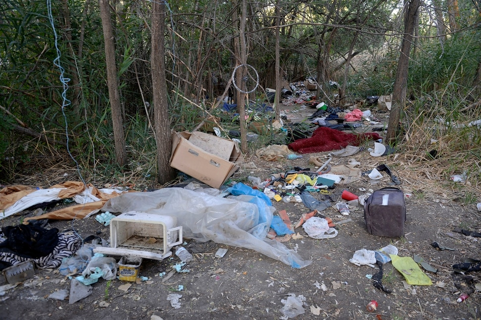 (Al Hartmann | The Salt Lake Tribune) After Operation Rio Grande, homeless camps have popped up everywhere. Some of the homeless have set up camps in the thick vegetation near the Jordan River south of 3900 South and 900 West, just 50 yards off the Jordan River Parkway Trail. Camps are full of garbage, tarps, coolers and sleeping bags. Disposal of human waste at the camps is a health problem.