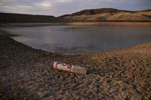 (AP Photo   John Locher) A buoy rests on the ground at a closed boat ramp on Lake Mead at the Lake Mead National Recreation Area near Boulder City, Nev. The U.S. Bureau of Reclamation released projections Wednesday, Sept. 22, 2021, that indicate an even more troubling outlook for a river that serves millions of people in the U.S. West. The agency recently declared the first-ever shortage on the Colorado River, which means Arizona, Nevada and Mexico won't get all the water they were allocated next year.