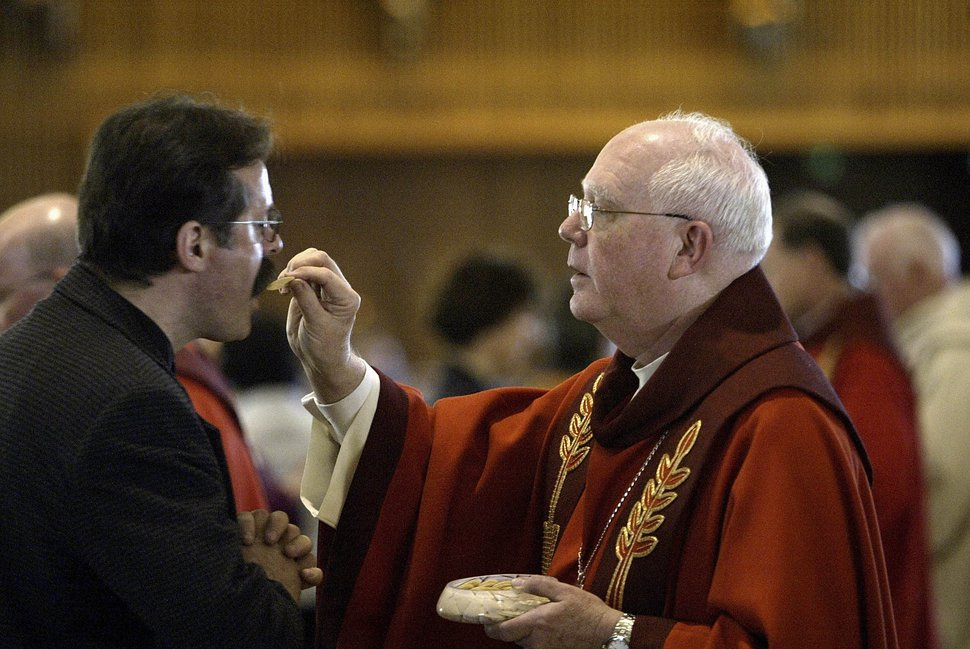 | Tribune File Photo Archbishop George H. Niederauer delivers communion after he is sworn in as the new Archbishop of San Francisco in St. Mary's Cathedral on February 15, 2006 in San Francisco, California.