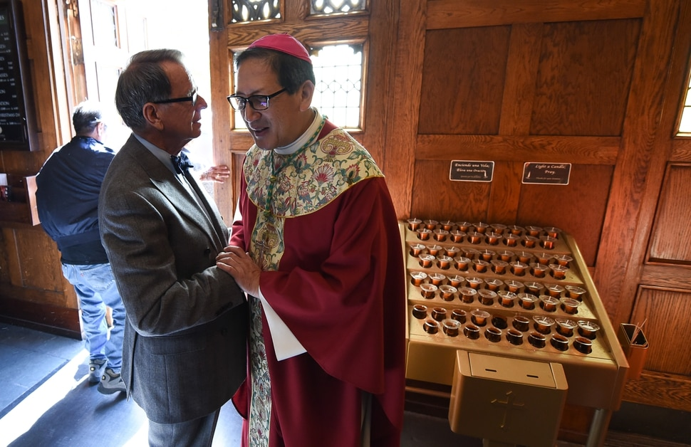 (Francisco Kjolseth | The Salt Lake Tribune) Attorney David Irvine meets Bishop Oscar Solis following a service for Utah's legal and criminal justice communities on Wednesday, Oct. 11, as part of a Red Mass at the Cathedral of the Madeleine in Salt Lake City. The mass, named for the red vestments worn by officiating clergy, goes back to the Middle Ages and traditional invokes the Holy Spirit's aid in dispensing justice.