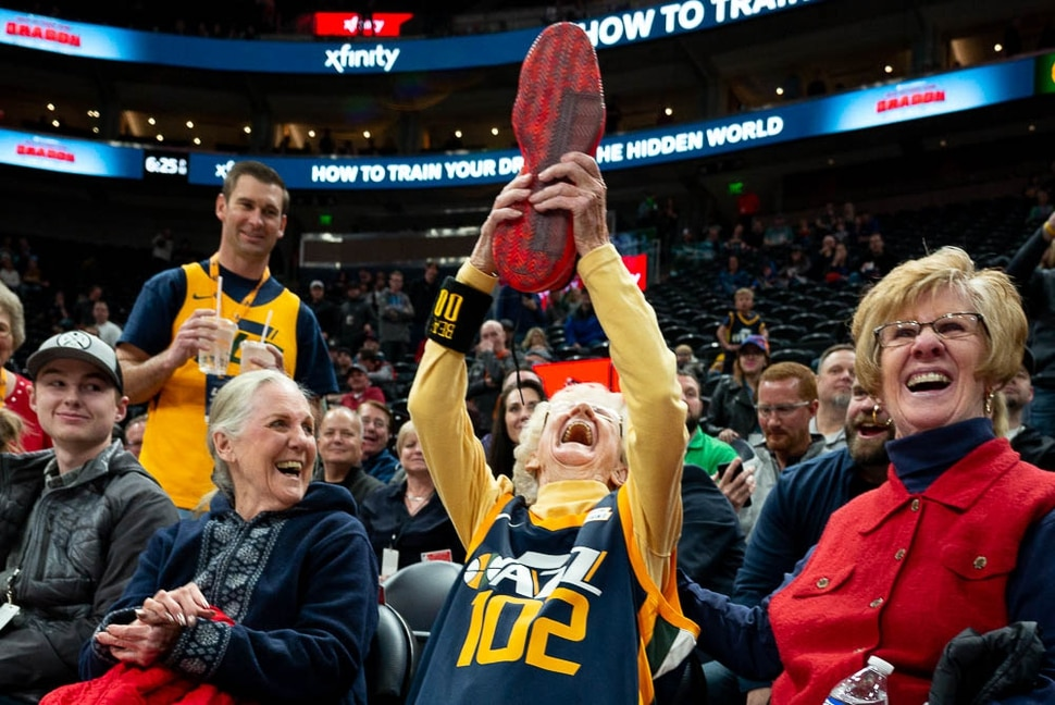 (Trent Nelson | The Salt Lake Tribune) 102-year-old Jazz fan Roberta Morgan holds up an autographed shoe given to her by Utah Jazz guard Donovan Mitchell (45) as the Utah Jazz host the Milwaukee Bucks, NBA basketball in Salt Lake City on Saturday March 2, 2019.
