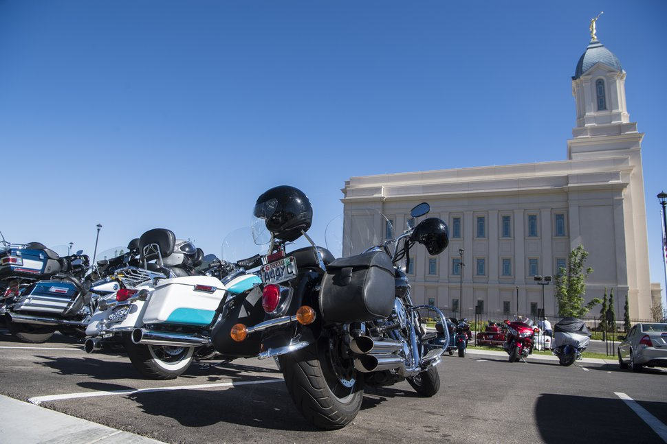 The Temple Riders, a faith-based motorcycle club visits the Cedar City Utah Temple as a stop on their biennial national rally Monday, June 11, 2018. The Temple Riders, a Mormon motorcycle club is holding its biennial gathering in southern Utah, where about 125 members from across the country are riding together through scenic parts of the region. (James M. Dobson/The Spectrum via AP)