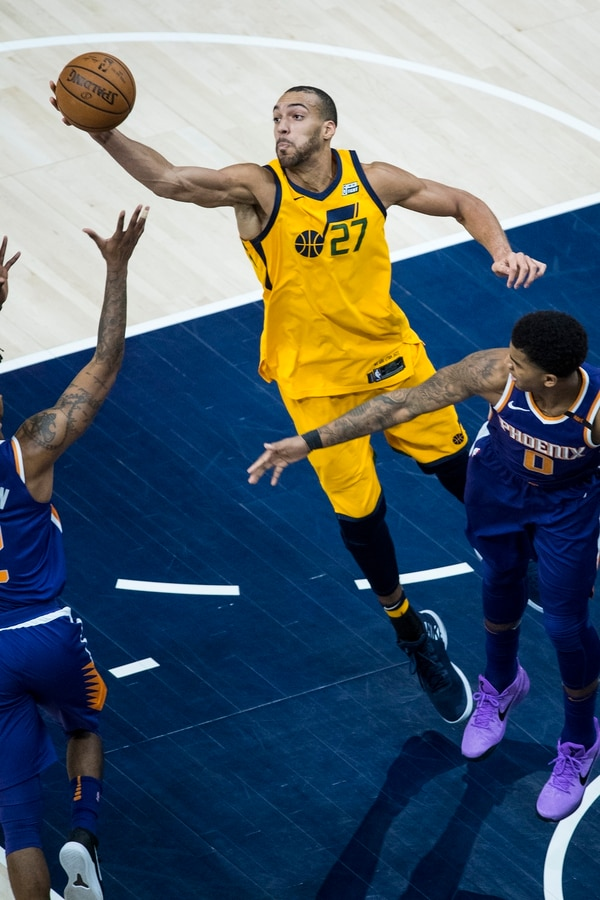 (Chris Detrick | The Salt Lake Tribune) Phoenix Suns guard Elfrid Payton (2), Utah Jazz center Rudy Gobert (27) and Phoenix Suns forward Marquese Chriss (0) go for the ball during the game at Vivint Smart Home Arena Thursday, March 15, 2018.