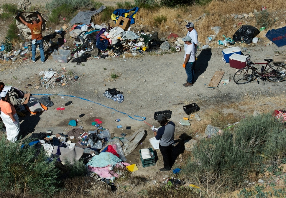 (Rick Egan | The Salt Lake Tribune) The Salt Lake Health Department, Salt Lake City Police and other partners conduct a camp cleanup in the hills east of Victory Road in Salt Lake. Thursday, June 14, 2018.