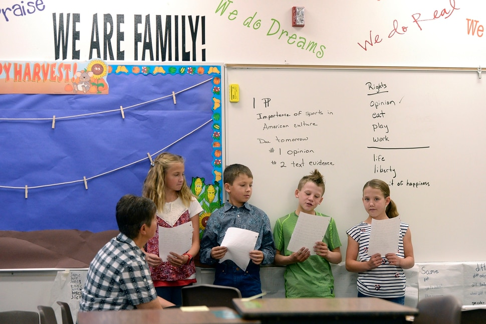 (Al Hartmann   The Salt Lake Tribune) Teachers aid Holly Carter with second and third graders at Park Valley School Wednesday August 30. Switching to a four-day school week made for long days but it left Fridays open for students to help on their family farms and ranches.